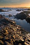 Coastal rocks at low tide at sunset, Pescadero State Beach, San Mateo County coast, California