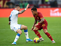 Football, Serie A: AS Roma - Brescia FC, Olympic stadium, Rome, November 24, 2019. <br /> Roma's Justin Kluivert (r) in action with Brescia's Stefano Sabelli (l) during the Italian Serie A football match between Roma and Brescia at Olympic stadium in Rome, on November 24, 2019. <br /> UPDATE IMAGES PRESS/Isabella Bonotto