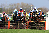 14h April 2018, Aintree Racecourse, Liverpool, England; The 2018 Grand National horse racing festival sponsored by Randox Health, day 3; Horses safely negotiate one of the hurdles in The Betway Mersey Novices' Hurdle