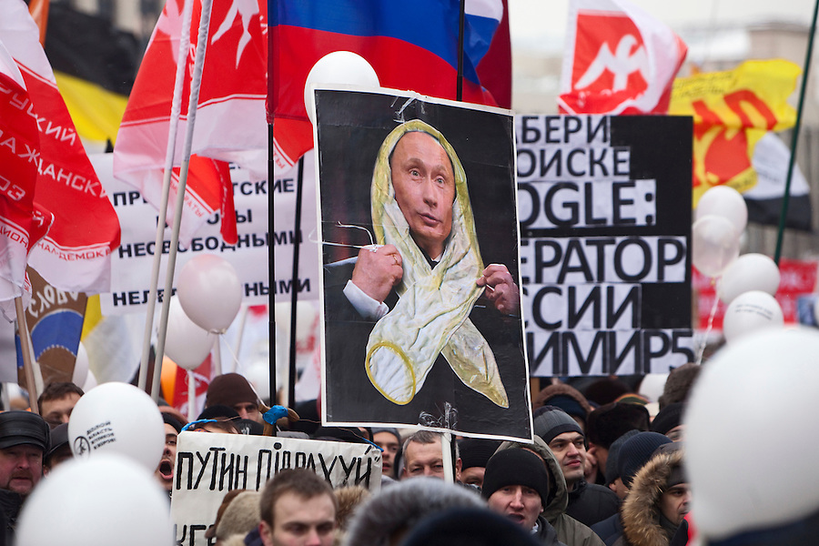 "Moscow, Russia, 24/12/2011..A placard with an image of Vladimir Putin wrapped in a condom, a response to Putin's description of opposition protestors' white ribbons ""looking like condoms"". An estimated crowd of up to 100,000 protested against election fraud and Prime Minister Vladimir Putin in the largest anti-government demonstration in Russia since the collapse of the Soviet Union."