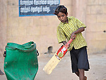A boy who works as a scavenger in the municipal garbage dump in Chennai, India, is hosted in a nearby night shelter by the Madras Christian Council of Social Service, where he plays cricket with other boys.