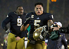 Oct. 13, 2012; Notre Dame line back Manti Te'o storms the field with teammates after Notre Dame defeated Stanford 20 to 13 in overtime. Photo by Barbara Johnston/University of Notre Dame