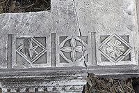 Fragment of carved stone decorations with floral designs in the ruins of the Homeric city of Troy, Hill of Hissarlik, Turkey. Troy was a city, both factual and legendary, in northwest Anatolia and was the setting of the Trojan Wars described in Homer's Iliad. Picture by Manuel Cohen