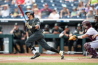 Vanderbilt Commodores third baseman Austin Martin (16) follows through on his swing during Game 8 of the NCAA College World Series against the Mississippi State Bulldogs on June 19, 2019 at TD Ameritrade Park in Omaha, Nebraska. Vanderbilt defeated Mississippi State 6-3. (Andrew Woolley/Four Seam Images)