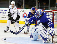 AMERICAN HOCKEY LEAGUE -- Toronto goalie Scott Clemmensen (30) makes a save as San Antonio's Chris Durno (25) races to capture the rebound before Toronto's Jaime Sifers (26) can get to it during the game between the Toronto Marlies and the San Antonio Rampage, April 21, 2008, at the AT&T Center in San Antonio, Texas. San Antonio won the game 3 - 2 to capture the lead in the first round Calder Cup playoffs series, 2 - 1. (Darren Abate/PressPhotoIntl.com)