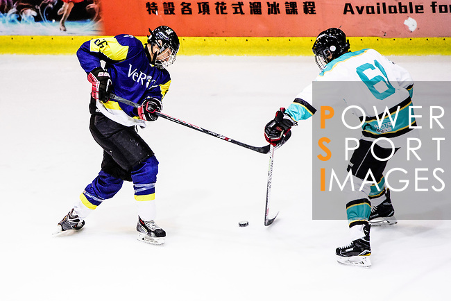 Verity Forward #66 Alan Chan (l) skates against Medical Kings Forward #61 Greg Gough (r) during the Principal Standard League match between Medical Winner Kings vs Verity at the Mega Ice on 17 January 2017 in Hong Kong, China. Photo by Marcio Rodrigo Machado / Power Sport Images