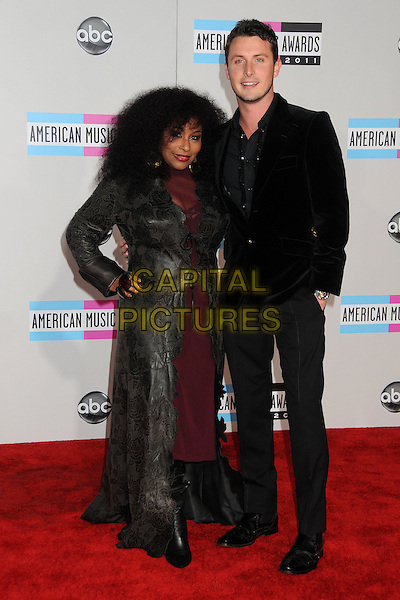 Chaka Khan & guest.2011 American Music Awards - Arrivals held at Nokia Theatre LA Live, Los Angeles, California, USA..November 20th, 2011.ama amas ama's full length black velvet suit jacket grey gray print long jacket hand on hip maroon dress.CAP/ADM/BP.©Byron Purvis/AdMedia/Capital Pictures.
