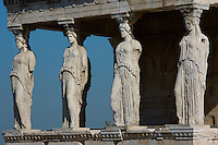 ATHENS, GREECE - APRIL 10 : A front view of the Porch of the Caryatids of the Erechtheum, on April 10, 2007, in Athens, Greece. The Erechtheum was built on the Acropolis, between 421 and 405 BC, in the Ionic Order. The Porch of the Caryatids is on the South side of the Temple and comprises 6 sculptures of maidens bearing libations, in place of columns, standing on a high base with bead and reel and egg and dart mouldings, and supporting a decorated flat roof. The Caryatids wear a Peplos with a short cloak hanging from their shoulders. Their long thick hair is braided around their head and falls on each shoulder down their back. (Photo by Manuel Cohen)