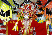costume, parade, Philadelphia, PA, Pennsylvania, A man in the Fancy Division is dressed in a colorful red oriental costume with feathers in the Mummers Day Parade on New Years Day in Philadelphia.