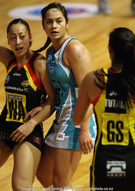 Magic wing attack Frances Solia is closely marked by Joanne Sutton as Maria Tutaia looks to pass during the ANZ Netball Championship match between the Waikato Bay of Plenty Magic and Adelaide Thunderbirds, Mystery Creek Events Centre, Hamilton, New Zealand on Sunday 19 July 2009. Photo: Dave Lintott / lintottphoto.co.nz