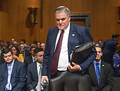 Charles P. Rettig prepares to take his seat at the witness table prior to giving testimony before the United States Senate Committee on Finance on his nomination to be Commissioner Of Internal Revenue (IRS) on Capitol Hill in Washington, DC on Thursday, June 28, 2018.<br /> Credit: Ron Sachs / CNP