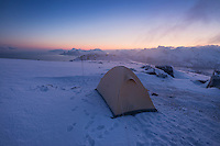 Tent at winter campsite on summit of Ryten, Moskenesøy, Lofoten Islands, Norway