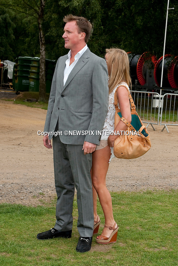 """GERI HALLIWELL.Geri Halliwell uses her boyfriend (Henry Beckwith) to hide from photographers as she fights with an underskirt, which had ridden up to vaguely reveal her knickers.Geri Halliwell and Henry Beckwith attend the 25th Cartier International Polo at Guards Polo Club, Windsor_26/07/09.Mandatory Photo Credit: ©Dias/Newspix International..**ALL FEES PAYABLE TO: """"NEWSPIX INTERNATIONAL""""**..PHOTO CREDIT MANDATORY!!: NEWSPIX INTERNATIONAL(Failure to credit will incur a surcharge of 100% of reproduction fees)..IMMEDIATE CONFIRMATION OF USAGE REQUIRED:.Newspix International, 31 Chinnery Hill, Bishop's Stortford, ENGLAND CM23 3PS.Tel:+441279 324672  ; Fax: +441279656877.Mobile:  0777568 1153.e-mail: info@newspixinternational.co.uk"""