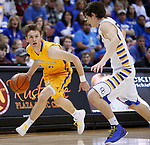 RAPID CITY, SD - MARCH 18, 2017 -- Johah Dohrer #20 of Aberdeen Central drives on Joey Messler #15 of Sioux Falls O'Gorman during the 2017 South Dakota State Class AA Boys Basketball Championship game Saturday at Barnett Arena in Rapid City, S.D.  (Photo by Dick Carlson/Inertia)
