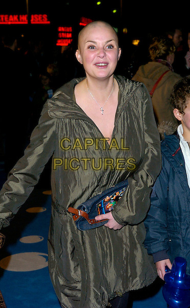 "GAIL PORTER .The premiere of ""Flushed Away"" at the Empire, Leicester Square, London, UK..November 23rd, 2006.half length green coat blue clutch purse bag.CAP/CAN.©Can Nguyen/Capital Pictures"