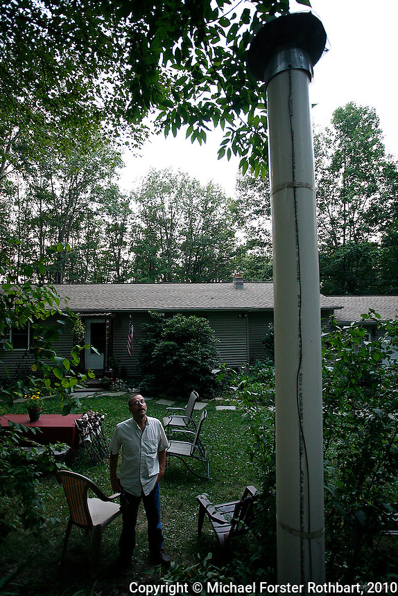 In Dimock, PA, Craig and Julie Sautner are among 14 families along Carter Road whose drinking water wells became contaminated with methane and other chemicals after gas drilling on their properties. Cabot Oil and Gas, the company held responsible by the Pennsylvania Department of Environmental Protection, has had at least 21 spills in Dimock Township in less than two years. <br /> <br /> &quot;Our water smells of diesel fuel,&quot; says Craig Sautner. &quot;In our water, we've found aluminum, manganese, chloride, iron, magnesium, sodium, strontium-T, all above the EPA limits, and TDS [Total Dissolved Solids] and other elements we can't disclose yet.&quot;  The Sautners' well has so much methane that Craig can sometimes light his water on fire, and Cabot had to install an exhaust pipe to vent off excess methane. <br /> <br /> Hydraulic fracturing or &quot;fracking&quot; is new method of drilling for natural gas: millions of gallons of water, sand and proprietary chemicals are pumped down a well under high pressure. The pressure fractures the shale, opening fissures so that natural gas can flow more freely. In August 2010, fracking is being widely used in the Marcellus Shale formation under Pennsylvania while New York considers a moratorium until the environmental effects can be reviewed. <br /> <br /> The 2005 Energy Policy Act exempted natural gas drilling from the Safe Drinking Water Act. Scientists have identified volatile organic compounds (VOCs) such as benzene, ethylbenzene, toluene, methane and xylene that have been found in contaminated drinking water near drilling sites. On the other hand, gas companies and property owners stand to earn up to one trillion dollars in profits from drilling in the Marcellus Shale.<br /> <br /> &copy; Michael Forster Rothbart<br /> www.mfrphoto.com <br /> 607-267-4893 o 607-432-5984<br /> 5 Draper St, Oneonta, NY 13820<br /> 86 Three Mile Pond Rd, Vassalboro, ME 04989<br /> info@mfrphoto.com<br /> Photo by: Michael Forster Rothbart<br /> Date: 8/2010    File#:  Canon 5D digital camera frame 68374