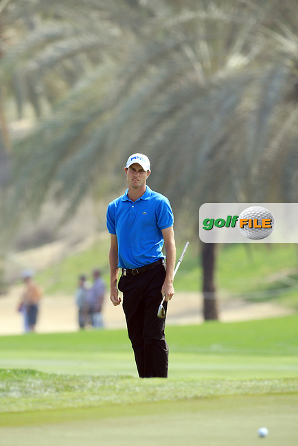 Rhus Davies (WAL) watches his third shot onto the green on the 8th.on day one of the Omega Dubai Desert Classic 2011 on the Majlis Course, Emirates Golf Club, Dubai, UAE. 10/02/2011.Picture Fran Caffrey/www.golffile.ie.