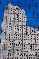 The National City Bank Building reflects in the glass of its neighbor in downtown Toledo, Ohio.