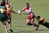 Rodney Tongotea tries to break free from Gregor Christie's tackle. Counties Manukau Premier Counties Power Club Rugby game between Karaka and Pukekohe, played at the Karaka Sports Park on Saturday March 10th 2018. Pukekohe won the game 31 - 27 after trailing 5 - 20 at halftime.<br /> Photo by Richard Spranger.