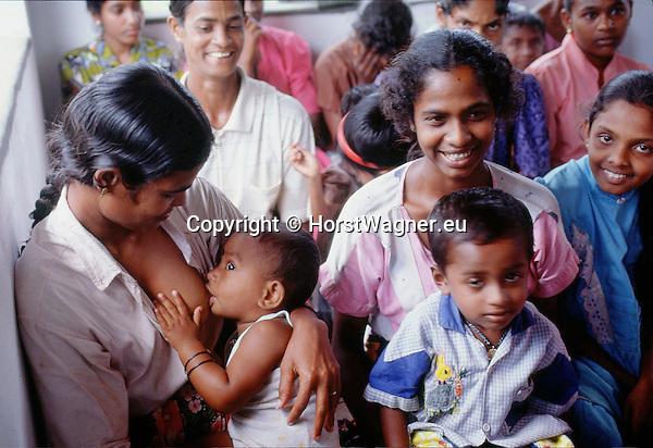 (97/18/22)-Anuradhapura-Sri Lanka - January 08, 1997 -- Woman breastfeeding her boy during a village meeting; FNS/SAN, rural, people -- Photo: © HorstWagner.eu