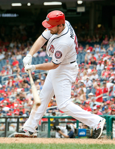 Washington Nationals second baseman Daniel Murphy (20) doubles in the eighth inning against the New York Mets at Nationals Park in Washington, D.C. on Tuesday, July 4, 2017.  Bryce Harper scored on the play giving Murphy his fifth R.B.I. for the day.  The Nationals won the game 11 - 4.<br /> Credit: Ron Sachs / CNP<br /> (RESTRICTION: NO New York or New Jersey Newspapers or newspapers within a 75 mile radius of New York City)