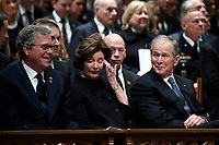 Former Florida Gov. Jeb Bush, Laura Bush and former President George W. Bush listen during a State Funeral for former President George H.W. Bush at the Washington National Cathedral, Wednesday, Dec. 5, 2018, in Washington.<br /> CAP/MPI/RS<br /> &copy;RS/MPI/Capital Pictures