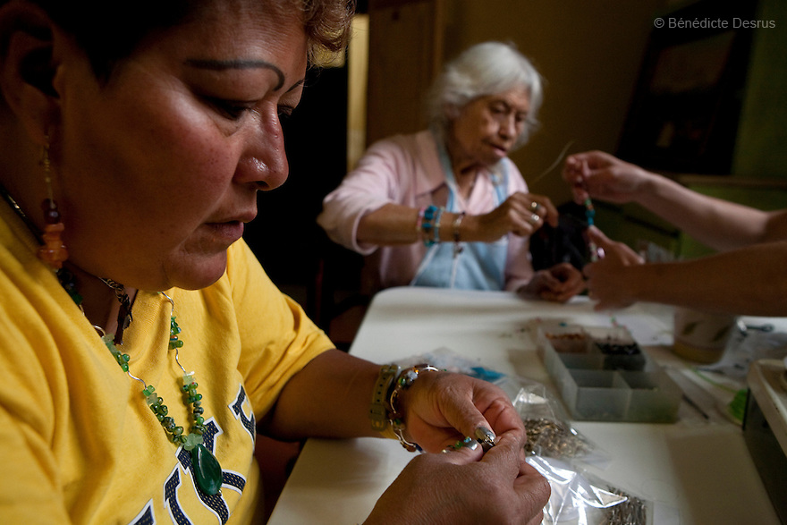 Paola y Reynita, both residents of Casa Xochiquetzal, during an arts and crafts workshop at the shelter in Mexico City, Mexico on July 9, 2008. Casa Xochiquetzal is a shelter for elderly sex workers in Mexico City. It gives the women refuge, food, health services, a space to learn about their human rights and courses to help them rediscover their self-confidence and deal with traumatic aspects of their lives. Casa Xochiquetzal provides a space to age with dignity for a group of vulnerable women who are often invisible to society at large. It is the only such shelter existing in Latin America. Photo by Bénédicte Desrus