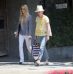 June 13th 2013<br /> <br /> January Jones wearing a fedora hat yellow white lace shirt black stripped jeans blue bag purse Little Dom's Restaurant in Los Feliz California.  Wearing eyelet top with rolled up pinstriped jeans and Oxford shoes. <br /> <br /> <br /> AbilityFilms@yahoo.com<br /> 805 427 3519<br /> www.AbilityFilms.com