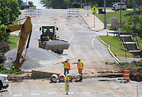 NWA Democrat-Gazette/DAVID GOTTSCHALK  Work continues Monday, July 2, 2018, on Maple Street along the north side of Razorback Stadium for reconstruction. Construction is expected to end when University of Arkansas' students return at the end of August and resume in May 2019, after graduation. The Maple Street work is part of a multi-year project on Razorback Road is widening it through the University of Arkansas campus from Martin Luther King Jr. Boulevard to Maple Street and up the hill to Garland Avenue. Maple Street will be four lanes with a new signal at Razorback and Maple, a modified signal at Maple and Stadium Drive and a mid-block pedestrian crossing, according to Paul Libertini, an engineer with the city. Razorback Road and Stadium Drive will be three lanes.