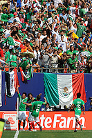 Carlos Vela (11) of Mexico (MEX) celebrates scoring with Giovani Dos Santos (17) and Gerardo Torrado (6). Mexico (MEX) defeated the United States (USA) 5-0 during the finals of the CONCACAF Gold Cup at Giants Stadium in East Rutherford, NJ, on July 26, 2009.