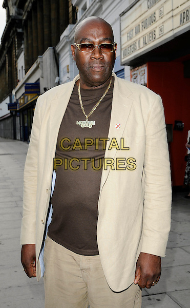 "CASS PENNANT .At the ""City Rats"" East End Film Festival VIP Screening, Genesis Cinema, Mile End Road, London, England, UK, .April 24th 2009..half length gold necklace sunglasses beige suit brown t-shirt .CAP/CAN.©Can Nguyen/Capital Pictures"
