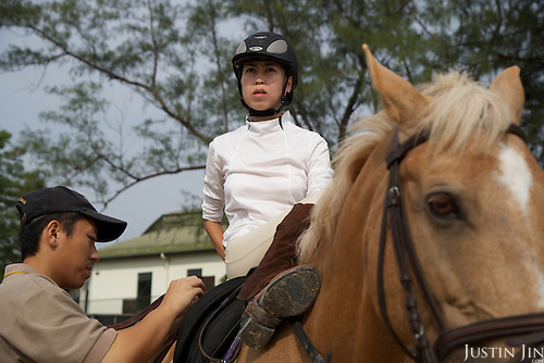 Ann, a pro shopper in Ariel's story, rides Gemini at the Shatin clubhouse.