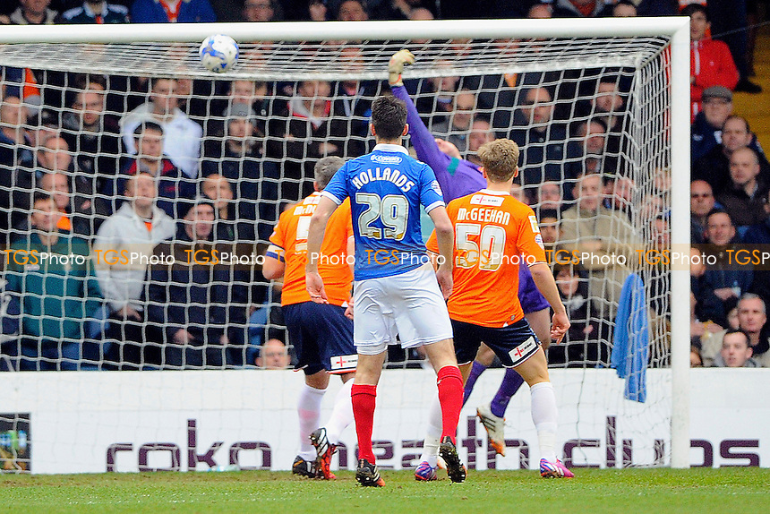 The shot from Matt Tubbs of Portsmouth beats Luton Town keeper Elliot Justham  for the first goal of the match- Portsmouth vs Luton Town - Sky Bet League Two Football at Fratton Park, Portsmouth, Hampshire - 14/03/15 - MANDATORY CREDIT: Denis Murphy/TGSPHOTO - Self billing applies where appropriate - contact@tgsphoto.co.uk - NO UNPAID USE