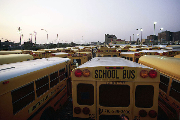 School buses parked in a lot at Coney Island.