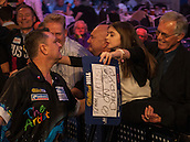 21.12.2014.  London, England.  William Hill World Darts Championship.  Kevin Painter (20) [ENG] gets a kiss from his daughter as he makes his way on stage for his game against Boris Koltsov [RUS]