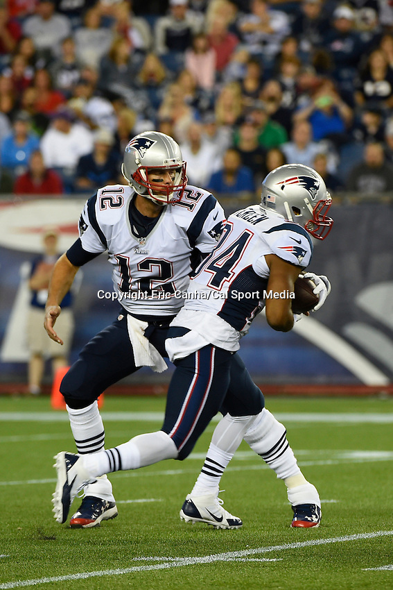 August 22, 2014 - Foxborough, Massachusetts, U.S.- New England Patriots quarterback Tom Brady (12) hands off the ball to running back Shane Vereen (34) during the NFL pre-season game between the New England Patriots and the Carolina Panthers held at Gillette Stadium in Foxborough Massachusetts. The Patriots defeated the Panthers 30-7 in regulation time. Eric Canha/CSM