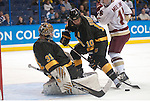 March 25,  2011             Colorado College defenseman Gabe Guentzel (10, right) tries to help Colorado College goalie Joe Howe (31) in the second period.  At right is Boston College forward Pat Mullane (11). The Boston College Eagles played against the Colorado College Tigers in the second semifinal of the NCAA Division 1 Men's West Regional Hockey Tournament, on Friday March 25, 2011 at the Scottrade Center in downtown St. Louis.