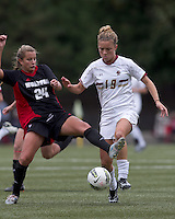 Boston College midfielder Kristen Mewis (19) on the attack as NC State defender Shelli Spamer (24) defends. Boston College defeated North Carolina State,1-0, on Newton Campus Field, on October 23, 2011.