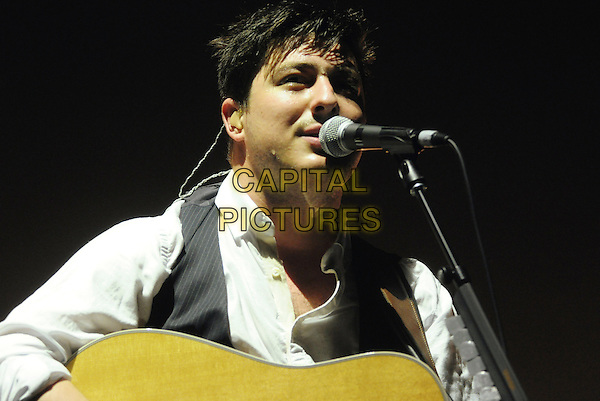 Marcus Mumford of Mumford & Sons.performs on stage at Copps Coliseum,  Hamilton, Ontario, Canada, .26th October 2011..music live gig concert performing half length microphone singing guitar .CAP/ADM/BPC.©Brent Perniac/AdMedia/Capital Pictures.