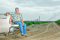 Harold Griffith on his corn field near the Xcel Energy Pawnee Generating Station in Fort Morgan, Colorado, Tuesday, July 21, 2015.<br /> <br /> Photo by Matt Nager