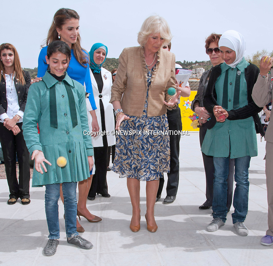 "CAMIILA, DUCHESS OF CORNWALL JUGGLES A BALL WATCHED BY QUEEN RANIA.The Duchess participated in an activity of bouncing a ball and catching it with alternate hands with the school girls from Mahes Secondary School for Girls, Amman_12/03/2013.The Royal couple are on a tour of four Middle Eastern countries..Mandatory credit photo:©DiasImages/NEWSPIX INTERNATIONAL..**ALL FEES PAYABLE TO: ""NEWSPIX INTERNATIONAL""**..PHOTO CREDIT MANDATORY!!: NEWSPIX INTERNATIONAL(Failure to credit will incur a surcharge of 100% of reproduction fees)..IMMEDIATE CONFIRMATION OF USAGE REQUIRED:.Newspix International, 31 Chinnery Hill, Bishop's Stortford, ENGLAND CM23 3PS.Tel:+441279 324672  ; Fax: +441279656877.Mobile:  0777568 1153.e-mail: info@newspixinternational.co.uk"
