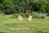 63821-20005 Yellow Adirondack chairs near flower bed, with bird bath, gazebo, Marion Co., IL