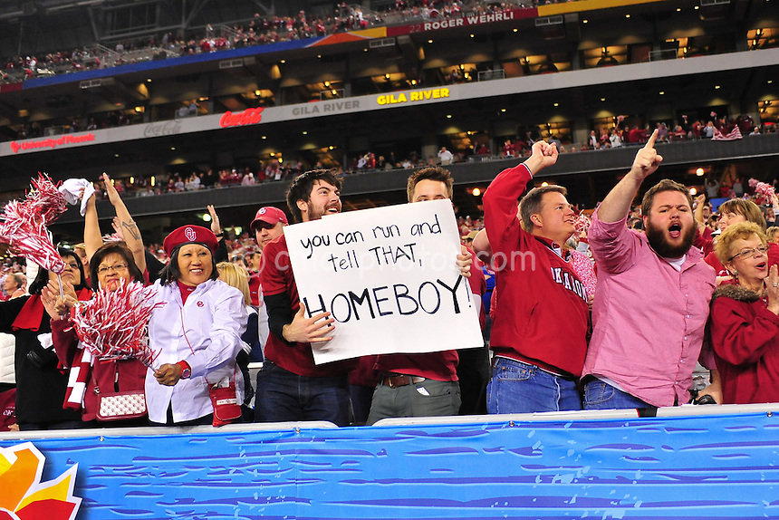 Jan 1, 2011; Glendale, AZ, USA; Oklahoma Sooners fans reacts to the final touchdown scored by the Sooners in the 4th quarter of a 48-20 victory over the Connecticut Huskies in the 2011 Fiesta Bowl at University of Phoenix Stadium.