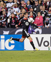 Chris Pontius (13) of D.C. United carries the ball upfield during the game at RFK Stadium in Washington, DC.  D.C. United defeated Chivas USA, 1-0.