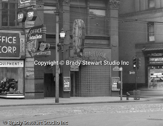 Pittsburgh PA:  View of the 700 block of Liberty Avenue from Wood Street - 1953.  View includes; General Office Equipment 719 Liberty and the Carnival Lounge at 725 Liberty.  Brady Stewart Studio moved into 725 Liberty Avenue (4th Floor) a year later. Nearby businesses included; Helfer's Jewelers, Dimling's Candies, Cole Optical, McFarren Typewriters, Equitable Gas Company, Iben and Irr Department Store and Max Azen's.