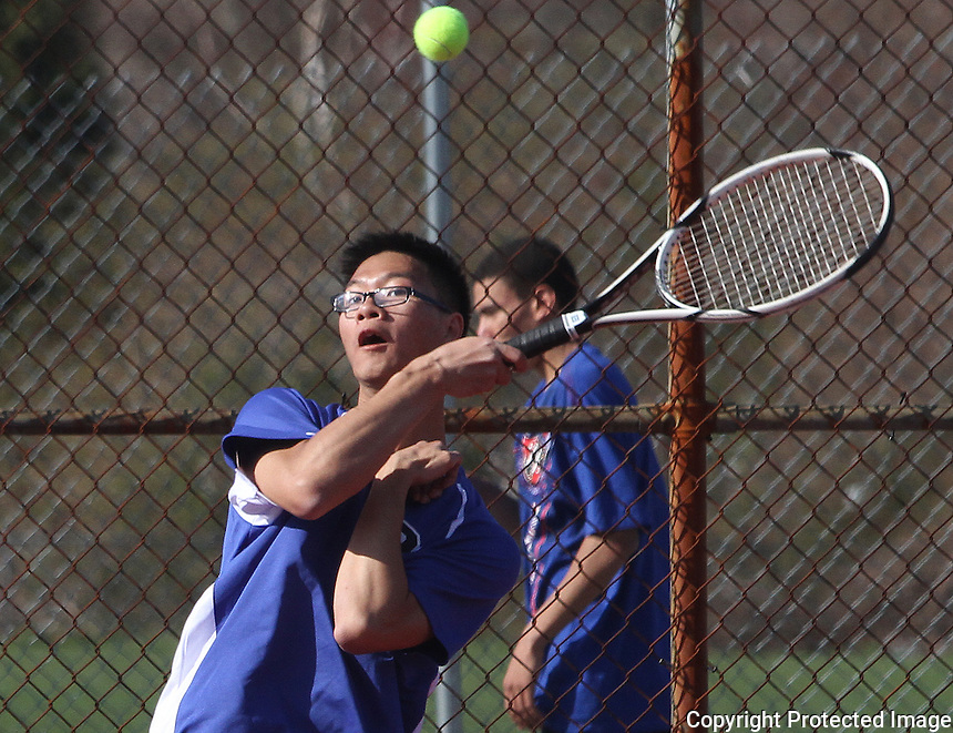 Randolph's Kevin Phi Hoang returns a volley during a doubles match between Randolph and Cohasset held at Randolph Middle School Wednesday April 24, 2013.(Photo by Gary Wilcox