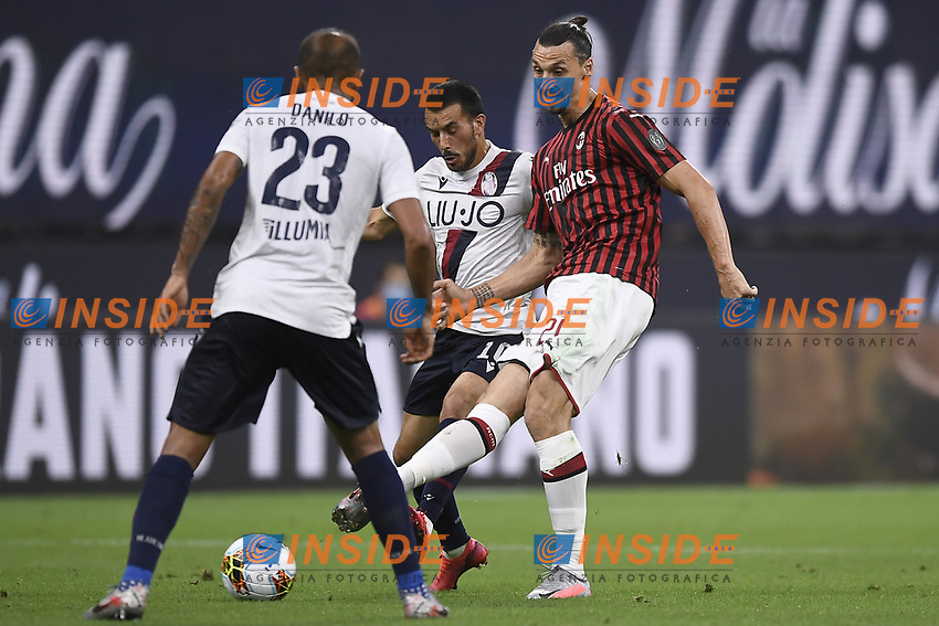 Nicola Sansone of Bologna FC and Zlatan Ibrahimovic of AC Milan compete for the ball during the Serie A football match between AC Milan and Bologna FC at stadio Giuseppe Meazza in Milano ( Italy ), July 18th, 2020. Play resumes behind closed doors following the outbreak of the coronavirus disease. <br /> Photo Image Sport / Insidefoto