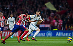 Karim Benzema (r) of Real Madrid competes for the ball with Thomas Teye Partey and Stefan Savic of Atletico de Madrid  during the La Liga 2017-18 match between Atletico de Madrid and Real Madrid at Wanda Metropolitano  on November 18 2017 in Madrid, Spain. Photo by Diego Gonzalez / Power Sport Images