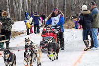 Michelle Phillips and team run past spectators on the bike/ski trail with an Iditarider in the basket during the Anchorage, Alaska ceremonial start of the 2015 Iditarod race. Photo by Ed Bennett/IditarodPhotos.com