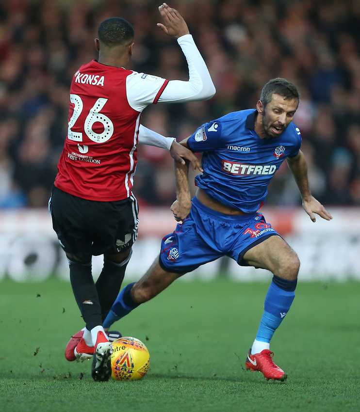 Bolton Wanderers' Gary O'Neil and Brentford's Ezri Konsa<br /> <br /> Photographer Rob Newell/CameraSport<br /> <br /> The EFL Sky Bet Championship - Brentford v Bolton Wanderers - Saturday 22nd December 2018 - Griffin Park - Brentford<br /> <br /> World Copyright © 2018 CameraSport. All rights reserved. 43 Linden Ave. Countesthorpe. Leicester. England. LE8 5PG - Tel: +44 (0) 116 277 4147 - admin@camerasport.com - www.camerasport.com